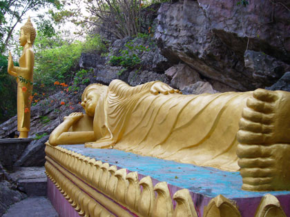 On the slopes of the 100m high Phu Si hill you pass many new Buddhist statues amid the ruins of an abandoned temple.