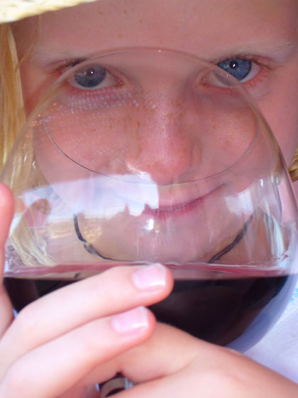 Ella becoming accustomed to the aromas of fine wine