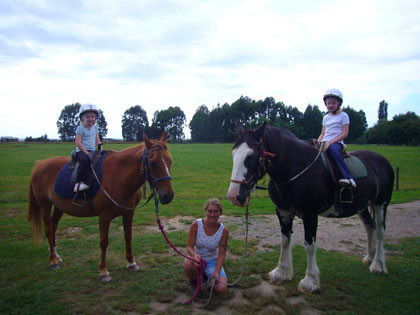 Ella and Florence on Ginger & Star on their horse ride in Marahau - bigger horses than they have ever had before!