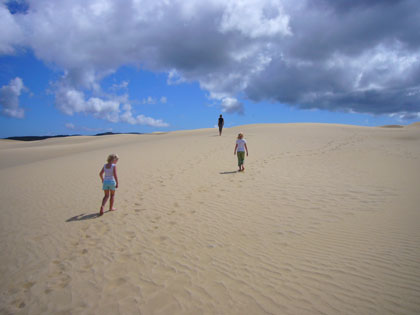 If you're fond of sand dunes and salty air -  this is the place to be!  Don't forget your toboggan (see video clip)