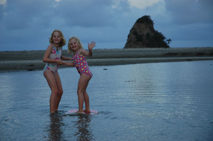 The girls enjoying our last beach stop in New Zealand at Waiwera - just 30 minutes north of Auckland.  They look so grown up!<br />