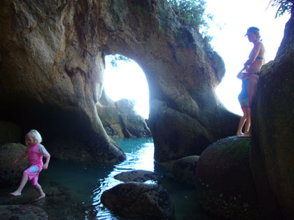 Exploring some caves during our stop at a secluded beach in the Abel Tasman National Park.  South Island.  NZ.